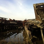 Photo taken at Staten Island Tugboat Graveyard by Deanne T. on 12/3/2011