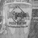 Photo taken at Oregano's Pizza Bistro by Scott J. on 6/22/2012