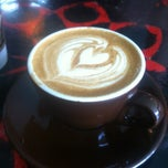 Photo taken at Barefoot Coffee Roasters by Melissa D. on 3/11/2012