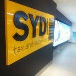 Photo taken at T1 International Terminal (SYD) by Dangar N. on 2/23/2012