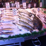 Photo taken at Pike Place Fish Market by Cory B. on 3/5/2012