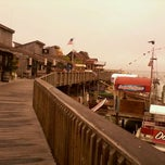 Photo taken at John's Pass Village and Boardwalk by Kyle R. on 12/26/2011