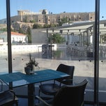 Photo taken at Καφέ & Εστιατόριο Μουσείου Ακρόπολης (Acropolis Museum Cafe Restaurant) by krasnec on 6/15/2012