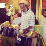Photo taken at Jawaiian Irie Jerk Restaurant by Mike P. on 8/4/2012