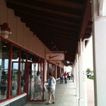 Photo taken at Nike Factory Store by Thilina R. on 5/12/2012
