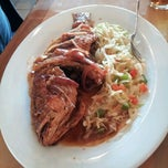 Photo taken at Jamaica Gates Caribbean Restaurant by Kimberly D. on 2/25/2012