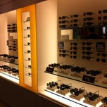 Photo taken at Sunglass Hut by Scotte H. on 9/11/2011