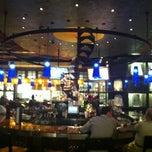 Photo taken at Table 10 by Emeril Lagasse by Samuel O. on 3/28/2012