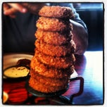 Photo taken at Red Robin Gourmet Burgers by Caitlyn M. on 8/27/2012