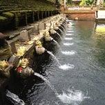 Photo taken at Pura Tirta Empul (Tirta Empul Temple) by Idd N. on 5/3/2012
