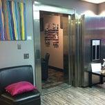 Photo taken at Blink27 Salon & Spa by Tina B. on 3/8/2012