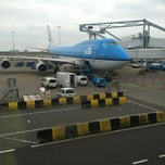 Photo taken at Gate E20 by Angie J. on 6/12/2012