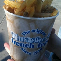 Photo taken at Thrasher's French Fries by Samantha Y. on 3/10/2012