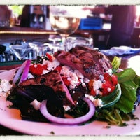 Photo taken at Beach Creek Oyster Bar & Grille by Brian S. on 7/30/2012