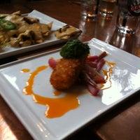 Photo taken at Nosh Kitchen Bar by Daniel C. on 5/21/2011