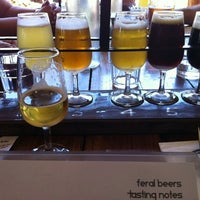 Photo taken at Feral Brewing Company by Annie S. on 12/26/2011