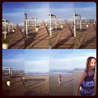Photo taken at Novavita Beach by Alberto N. on 8/26/2012