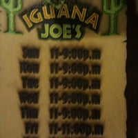 Photo taken at Iguana Joe's by Caramels' D. on 1/18/2012