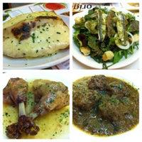 Photo taken at Origens Restaurant by Elisa L. on 5/22/2012