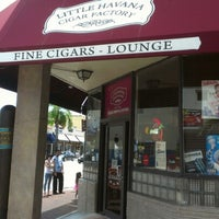 Photo taken at Little Havana Cigar Factory by Ryan H. on 6/18/2012