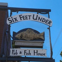 Photo taken at Six Feet Under Pub & Fish House by La'Leatha S. on 9/23/2012