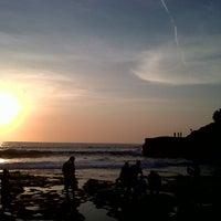 Photo taken at Tanah Lot Beach by Adithia W. on 10/21/2012