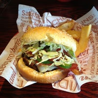 Photo taken at Red Robin Gourmet Burgers by Brandon L. on 5/23/2013