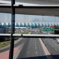 Photo taken at Emirates Metro Station محطة مترو طيران الإمارات by DF P. on 5/10/2014