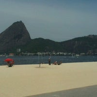 Photo taken at Praia do Flamengo by Maíra D. on 10/20/2012