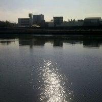 Photo taken at 神崎川河川敷 by Shinichi M. on 12/14/2012
