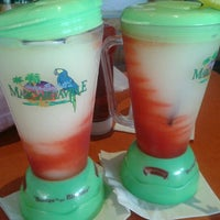 Photo taken at Margaritaville Bar & Grill by Tracey P. on 8/19/2013