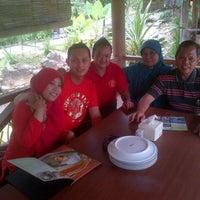 Photo taken at Restoran Kampung Nirwana by Hidayat A. on 3/16/2014