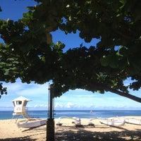 Photo taken at Makaha Beach Park by Lika J. on 7/6/2013