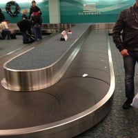 Photo taken at Orlando International Baggage Claim by Jefferson G. on 12/20/2012