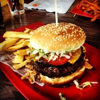 Photo taken at Red Robin Gourmet Burgers by Brad C. on 4/14/2013