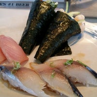 Photo taken at Minato Sushi Cafe by Mark B. on 6/18/2014