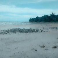 Photo taken at Santubong Beach by Kamarul H. on 11/5/2013