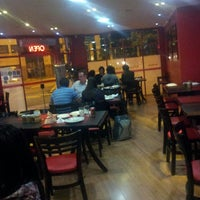 Photo taken at Super Pizza Pan by Jun-Young K. on 4/27/2013