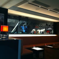 Photo taken at EMPORIO ARMANI CAFFE by Sergey G. on 11/11/2012