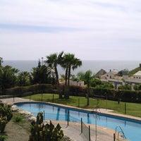 Photo taken at Playa de Calabajío by Kelly d. on 4/9/2014