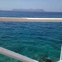 Photo taken at Nur Beach by Bahar G. on 6/26/2013