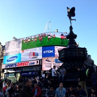 Photo taken at Piccadilly Circus by Olya S. on 5/1/2013