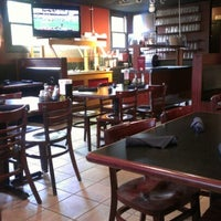 Photo taken at Erbelli's Gourmet Pizzeria, Italian Bistro & Pub by Ashley H. on 9/22/2012