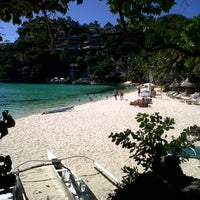 Photo taken at Diniwid Beach by Princess F. on 4/18/2013