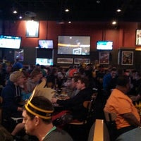 Photo taken at Buffalo Wild Wings by Kristen A. on 4/4/2014