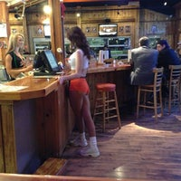 Photo taken at Hooters by Ariel V. on 2/13/2013