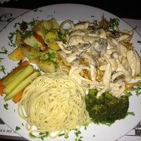 Photo taken at Cafe Cafe by Yasemin E. on 3/21/2013