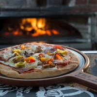 Photo taken at The Rock Wood Fired Kitchen by The Rock Wood Fired Kitchen on 7/31/2015