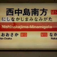 Photo taken at Nishinakajima-Minamigata Station (M14) by Miyuki S. on 1/1/2013