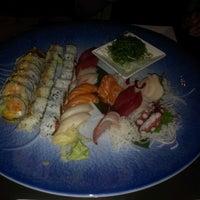 Photo taken at Tomodachi Sushi by Samuel Y. on 2/27/2013